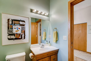 The half bathroom off the main entrance is perfect for guests, and also as a pass through to the huge flex room.