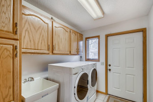 No need to haul your laundry downstairs-just step behind the kitchen and into the main level laundry.