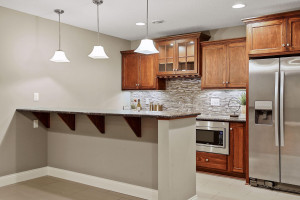 Gorgeous wet bar includes a microwave, wine fridge, and a full sized refrigerator!