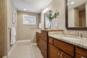 Master bathroom features a double vanity and custom walk-in shower