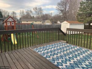 Large deck overlooks fully fenced flat yard