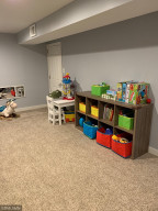 Toy room offers a large walk in storage closet.
