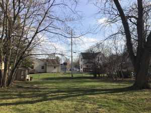 Beautiful flat, fully fenced yard! Shed stays with home!