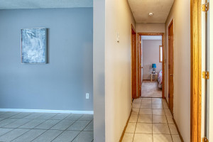 Hallway to bath and bedrooms. Ceramic tile through much of the main floor.