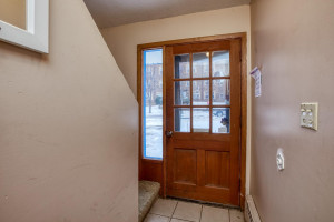 Front entry of home give access to both units and laundry room.