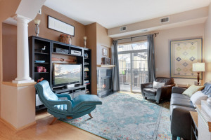 Living area features charming gas fireplace