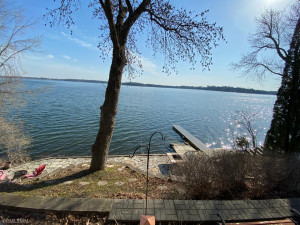 Deck area overlooking flagstone patio and lakeshore