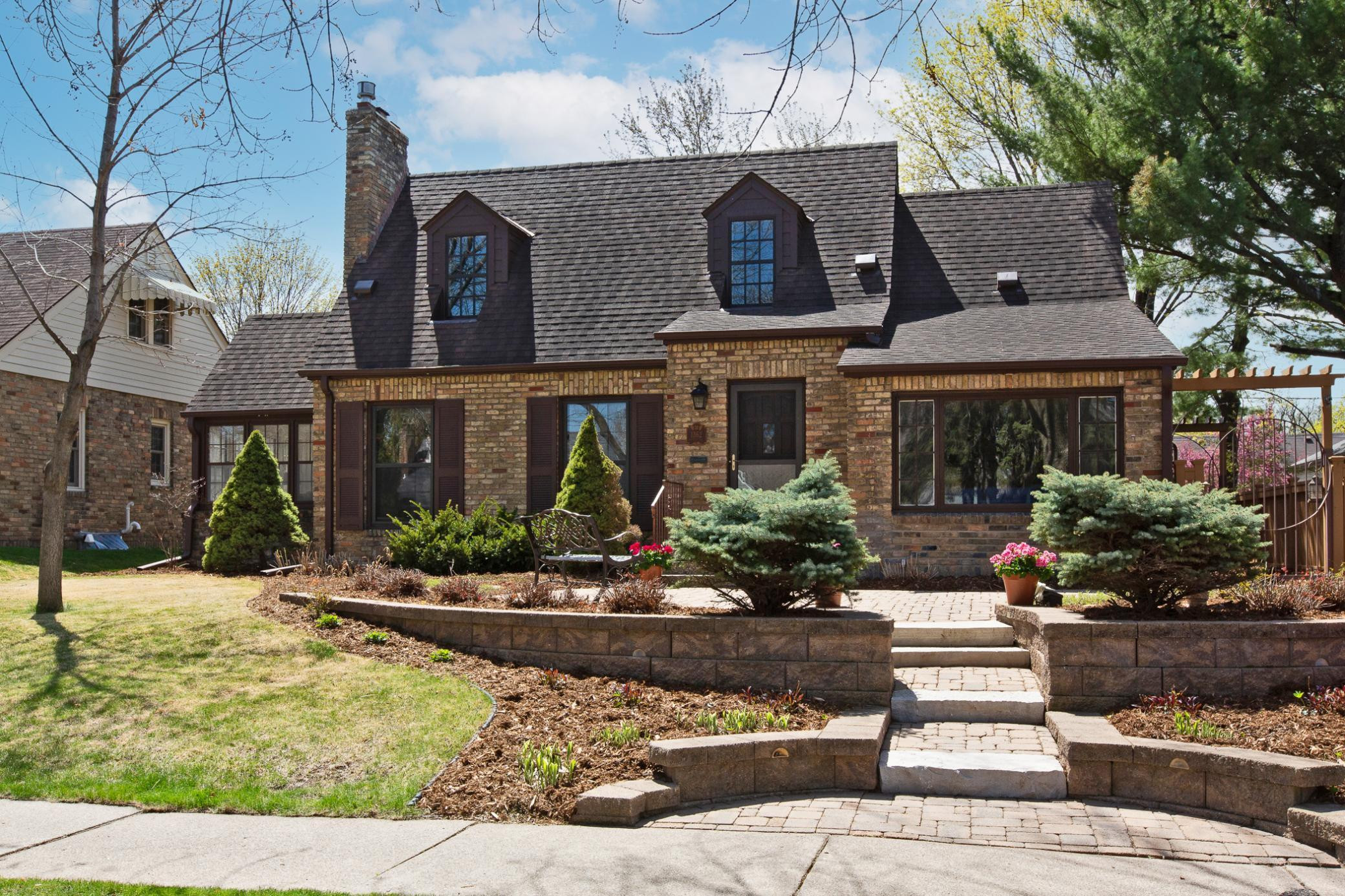 Beautifully landscaped Cottage style home