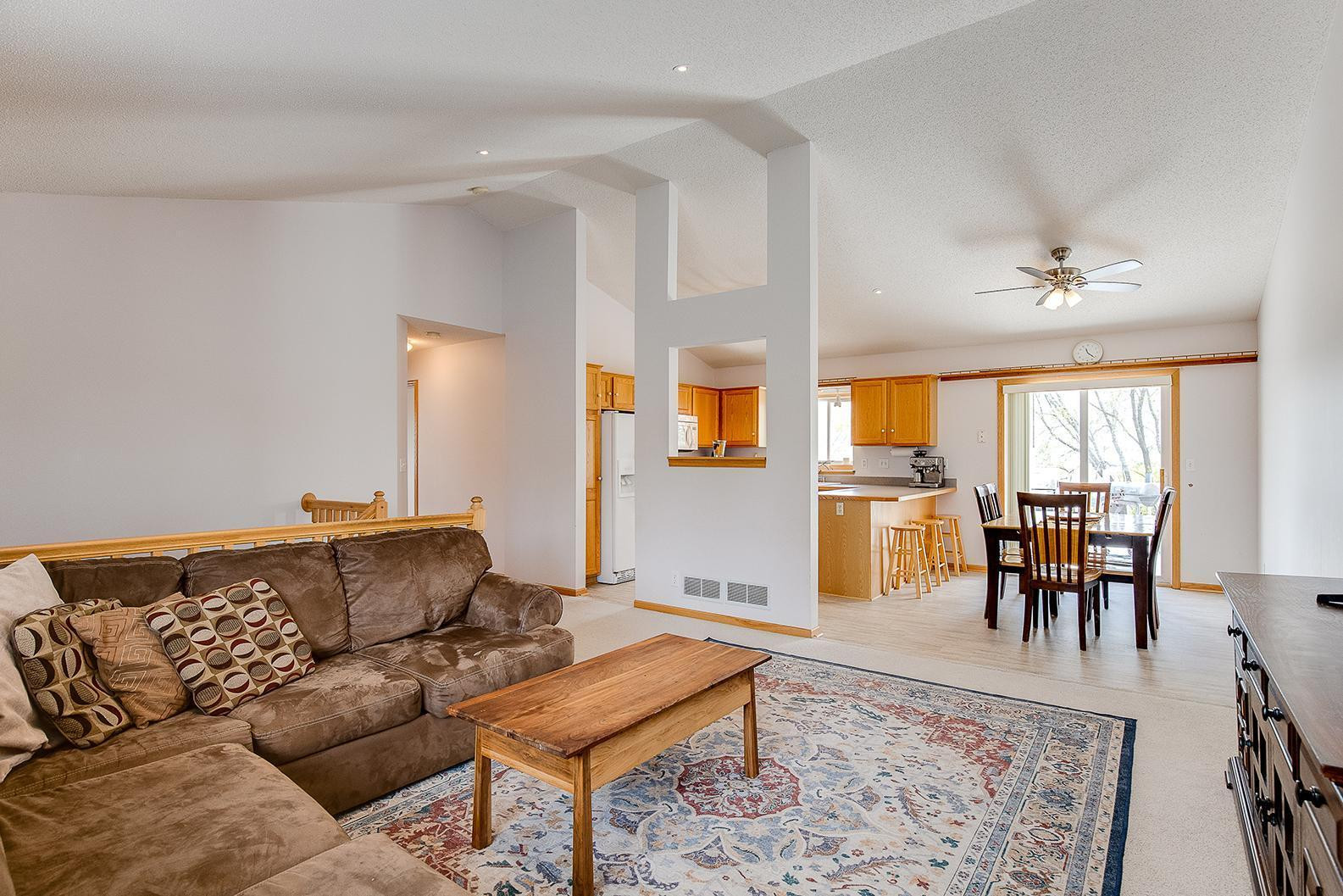 Living room is open directly to the kitchen and dining area. Make sure to check out those vaulted ceilings as well!!