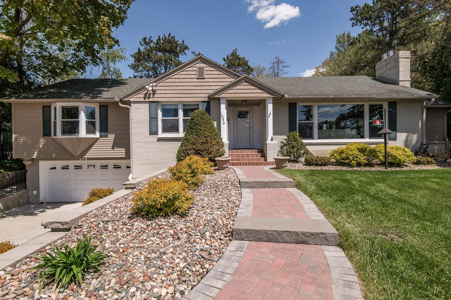 Shaker siding accents, great walk-ways and retaining walls (new in 2020), and nice landscaping gives this beautiful home great curb appeal!