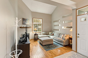 Spacious and open living room with the vaulted ceiling