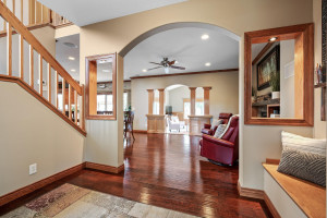 Large Entry in home with bench seat and coat closet off to the right upon entry