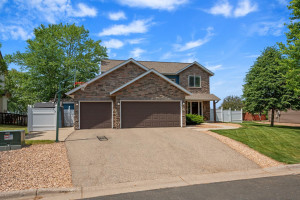 3 Car Garage with fence area to hide unsightly garbage cans and shed