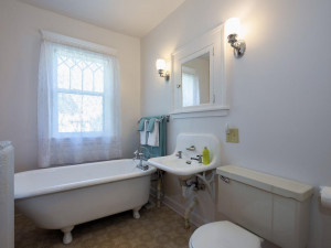 Upper level full bath. Claw foot tub and sink recently resurfaced. Also, has a built-in linen closet and medicine cabinet.