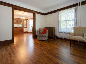 11 Ft ceilings. View from living room into the dining room. Large windows allows plenty of natural light in. Wood crown molding and high baseboards.