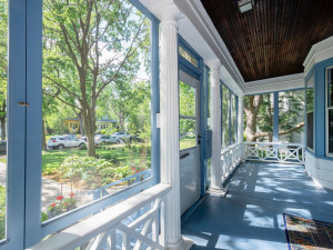 Enjoy this spacious screened in porch for family gatherings or watching the rain storms in the summer. Wainscoting ceiling.