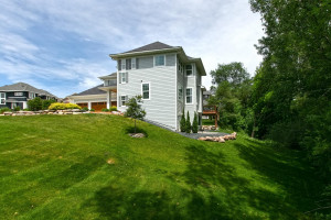 Gorgeous lot with mature trees lining the back of the lot