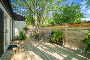 Step outside the family room to this private deck