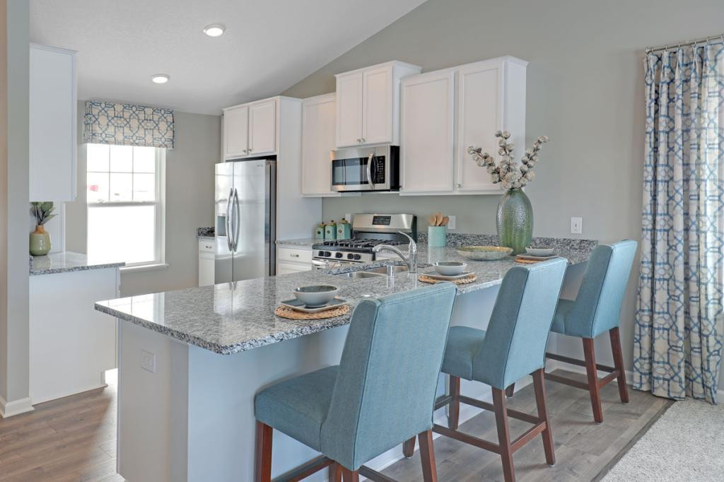 Granite, stainless steel appliances, white maple cabinetry on an open and airy floorplan! (Model photo, actual home will vary in colors)