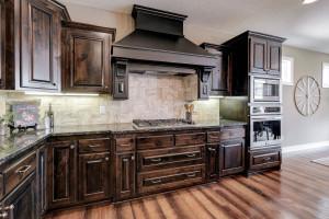 Gorgeous granite counters, gas range & vent hood