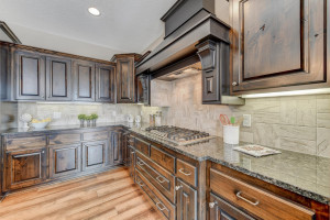 One-of-a-kind knotty Alder cabinets with a hidden spice rack!