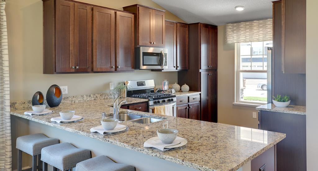 The popular Rushmore boasts a kitchen that is equal parts smart and useful - and comes loaded with a stainless steel appliance package. Photo of model home, finishes will vary.