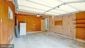 Garage Stall closets to the home and the bigger of the 2 stalls