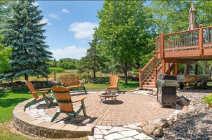 A designer paver patio is sure to impress anyone stopping by.