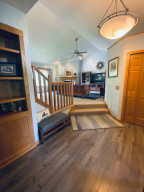 A large entryway with a built-in can showcase anything you choose in this large foyer. Come on in. It's time to eat!