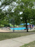 Pershing Park has a wading pool, play area, tennis, basketball, baseball fields