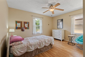 Main floor bedroom 2 with hardwood floors