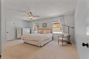 Main floor owners bedroom is large and features two closets plus newer carpet