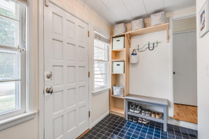 Mud room is conveniently located between the kitchen and attached garage. It has a separate entrance to the front of the home.