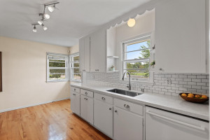 Kitchen with newer granite counters, sink, faucet, subway tile and Bosch dishwasher