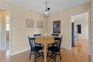 Dining area with hardwood floors and newer light fixture