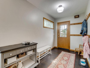 Fantastic mudroom adjacent to the kitchen with built in storage