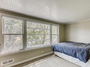 Upper level Guest room/den/office with built in desk and shelves