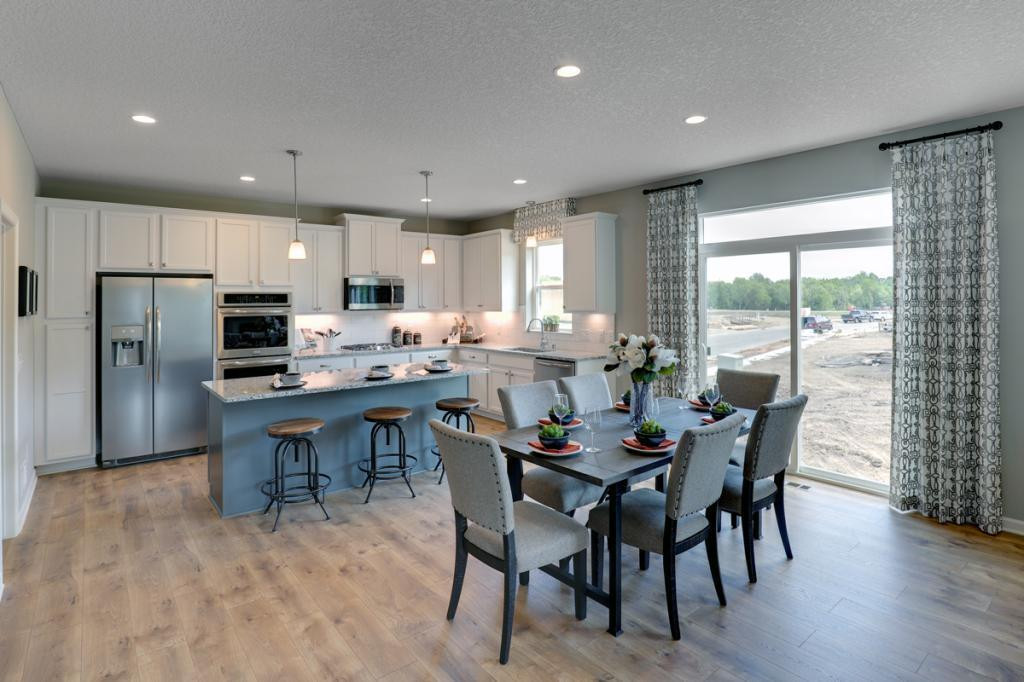 Situated just off the kitchen, the homes dining area stretches 17-feet across, leaving enough space to accommodate just about any table! *Photo of previous model. Selections may vary, please see agent for details.