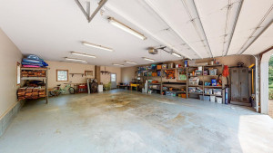 Inside 2 Car Garage with woodburning stove