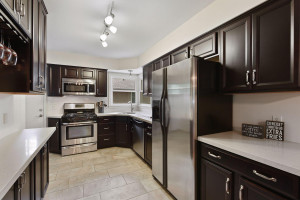 Easy to entertain here. Stainless appliances, solid surfaces and two huge windows.