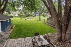 THE YARD EXTENDS PAST FENCED AREA. New paver patio and fenced area of yard for pets or play.