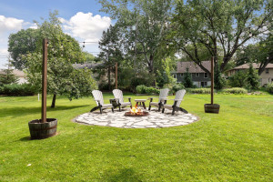 Enjoy firepit area and gardens in the back.