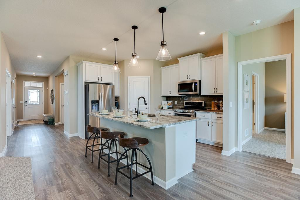 A kitchen built to perform! Equipped with stainless steel appliances, granite countertops and a large island, this kitchen adds distinction and character! *Photo of previous model home, this home's colors are similar but selections will vary