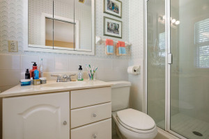 Private Owner's bath has shower with glass enclosure.