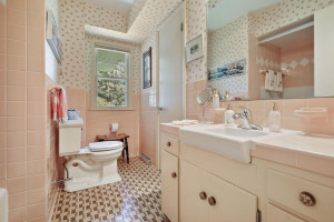 Full hall bath with classic tilework and shower & tub.