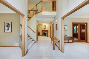 As you enter the home, the large two-story entry leads to the living areas of the first floor. Living room to the right, formal dining to the left, and main level family room and study straight ahead.