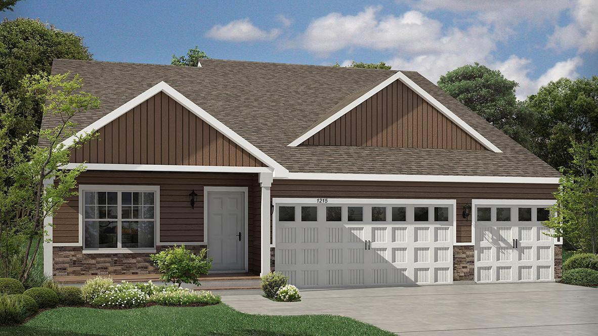 This is our Everett floor plan with front Heartland Cottage elevation. Features 4 beds, 3 bath and 3 car garage. Exterior color planned for the home is a Harvard Slate and Ironstone peaks.