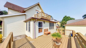 Large Main Level Deck Walks Out from Enclosed 3 Season Porch