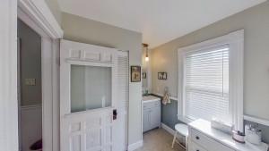 Main Floor 3/4 Bath has Charming Paneled Door