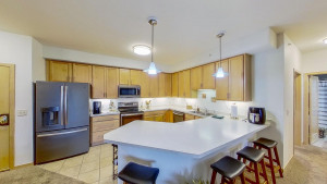 Kitchen with tile floors and new appliances